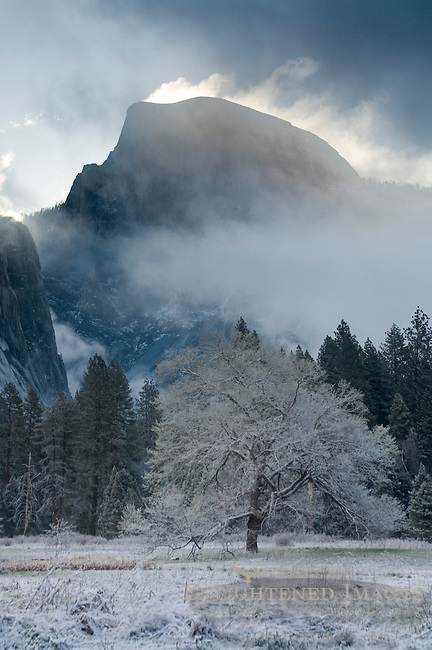 Clouds over Half Dome at sunrise after Spring snow storm, Yosemite Valley, Yosemite National Park, California