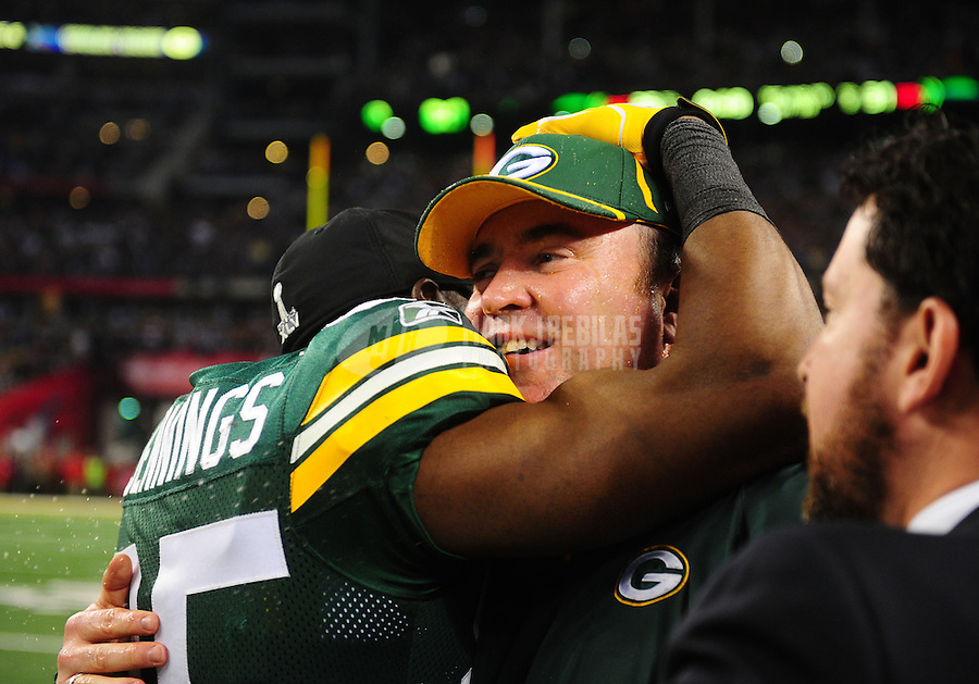 Feb 6, 2011; Arlington, TX, USA; Green Bay Packers head coach Mike McCarthy hugs wide receiver Greg Jennings (85) after the Packers defeated the Pittsburgh Steelers in Super Bowl XLV at Cowboys Stadium.  Mandatory Credit: Mark J. Rebilas-