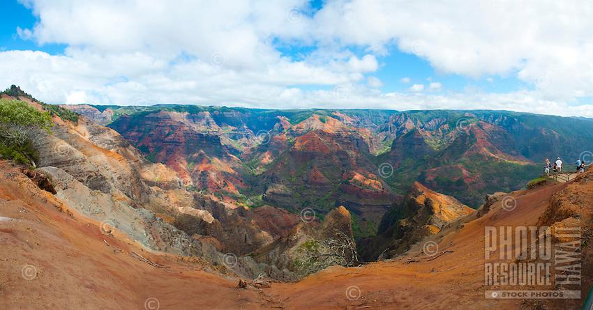 Visitors viewing the vivid colors and rock formations at Waimea Canyon, Kauai.