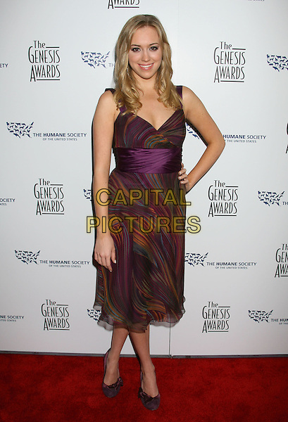 ANDREA BOWEN .22nd Annual Genesis Awards held at the Beverly Hilton Hotel,  Beverly Hills, California, USA,  29 March 2008..full length purple print dress hand on hip .CAP/ADM/RE.©Russ Elliot/Admedia/Capital PIctures