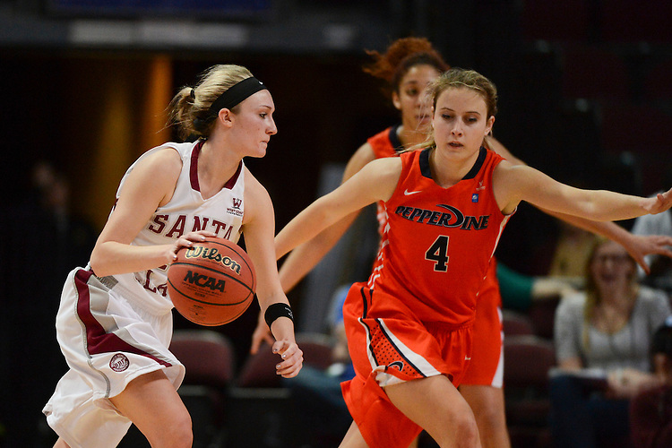 March 6, 2014; Las Vegas, NV, USA; Santa Clara Broncos guard Nici Gilday (12) dribbles against Pepperdine Waves guard Grace Leah Baughn (4) during the second half of the WCC Basketball Championships at Orleans Arena. The Waves defeated the Broncos 80-74.