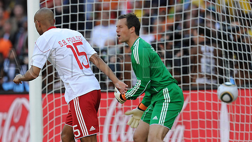 Denmark's goalkeeper Thomas Sorensen shouts after his team-mate Simon Poulsen scored an own-goal during the 2010 FIFA World Cup group E match between the Netherlands and Denmark at Soccer City stadium in Johannesburg, South Africa, 14 June 2010.