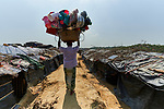 A vender sells household wares in the Jamtoli Refugee Camp near Cox's Bazar, Bangladesh. More than 600,000 Rohingya refugees have fled government-sanctioned violence in Myanmar for safety in this and other camps in Bangladesh.