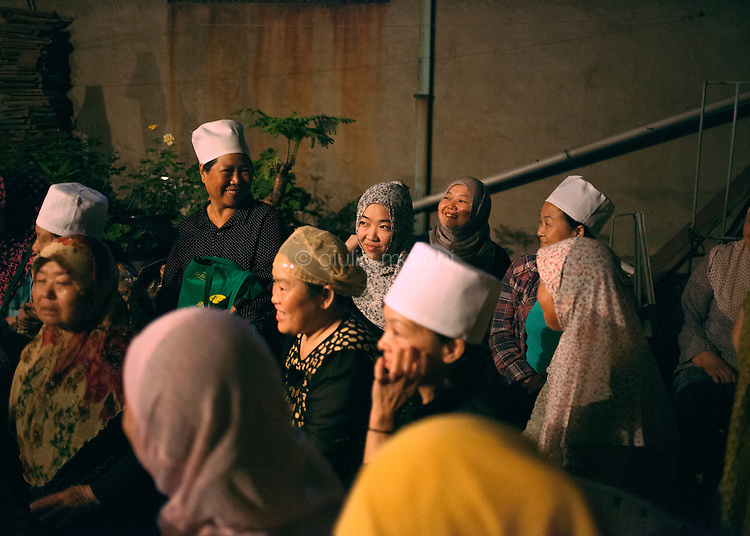 China / Henan Province / Luoyang / 17.6.2013 / Muslim women gather in Luoyang to read the Koran. Ding Lan, back from Cairo where she studies Arabic, is supposed to show them how to pronounce it in the correct way.<br />