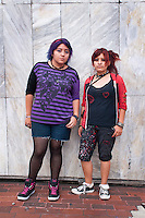 Friends Andrea Florentino Sabino ( red hair 18 years old) and Jacqueline Davila Chavez (purple hair 19 years old). Portraits of Adolescents, glorieta de Insurgentes, in Mexico City. Releases # 19 and 20