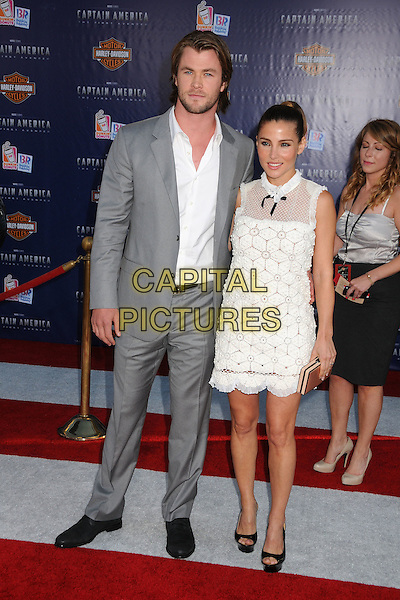 "Chris Hemsworth & Elsa Pataky.Premiere of ""Captain America: The First Avenger"" held at The El Capitan Theatre in Hollywood, California, USA..July 19th, 2011.full length dress platform open toe shoes white sheer crochet black bow sleeveless hair up shirt grey gray suit married husband wife.CAP/ADM/BP.©Byron Purvis/AdMedia/Capital Pictures."
