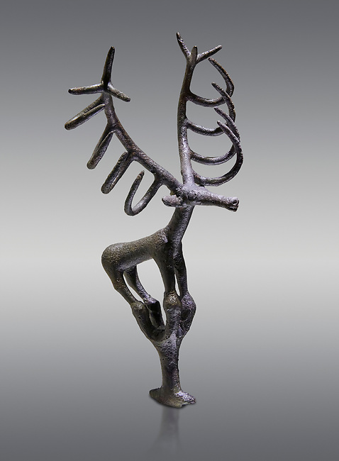 Bronze Age Hattian ceremonial deer statuette in bronze from a possible Bronze Age Royal grave (2500 BC to 2250 BC) - Alacahoyuk - Museum of Anatolian Civilisations, Ankara, Turkey. Against a gray background