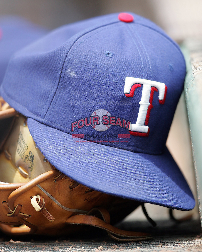 Texas Rangers baseball cap and glove. Photo by Andrew Woolley .