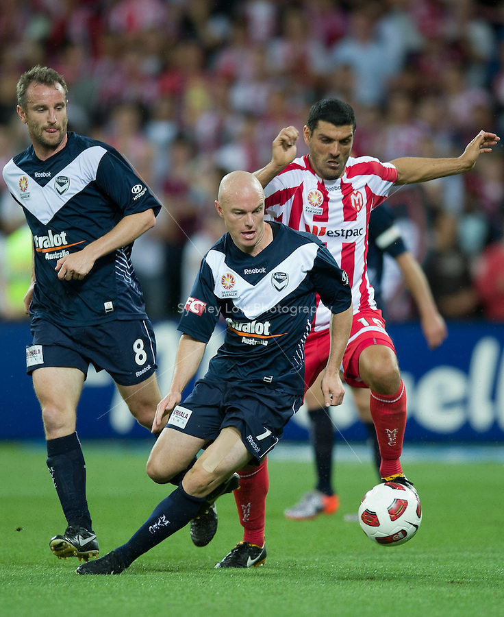 MELBOURNE, AUSTRALIA - DECEMBER 11: Matthew Kemp of the Victory protects the ball during the round 18 A-League match between the Melbourne Heart and Melbourne Victory at AAMI Park on December 11, 2010 in Melbourne, Australia. (Photo by Sydney Low / Asterisk Images)