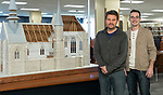 Owner David Wegter, left, and model designer Stephen Moroz, both of the architectural and engineering model making firm Presentation Studios International, with a scale model of the Church at Folleville, France, on display on the second floor of the Richardson Library on the Lincoln Park Campus. The church is where on Jan. 25, 1617, St. Vincent de Paul preached a sermon which led to the foundation of the Congregation of the Mission and all of his works. The model captures what the church looked like on that day. The church is still in existence but has undergone many changes over its 500 year history. (DePaul University/Jeff Carrion)