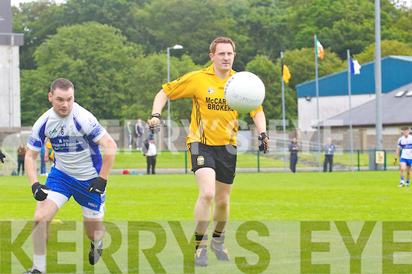 Castleisland Desmond's Barry Lynch races against Noel Kennelly of Listowel Emmets last Sunday in Listowel.