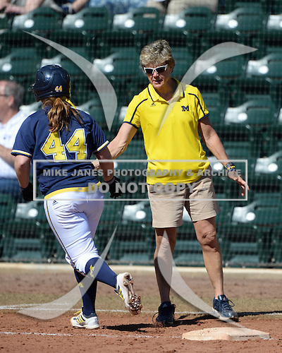 Michigan Wolverines Softball head coach congratulates infielder Caitlin Blanchard (44) running the bases after hitting a home run during a game against the Bethune-Cookman on February 9, 2014 at the USF Softball Stadium in Tampa, Florida.  Michigan defeated Bethune-Cookman 12-1.  (Copyright Mike Janes Photography)