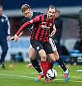 St Johnstone's Dave Mackay holds off Dundee's Greg Stewart.