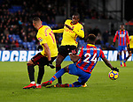 Crystal Palace's Timothy Fosu-Mensah tussles with Watford's Richarlison and Abdoulaye Doucoure during the premier league match at Selhurst Park Stadium, London. Picture date 12th December 2017. Picture credit should read: David Klein/Sportimage