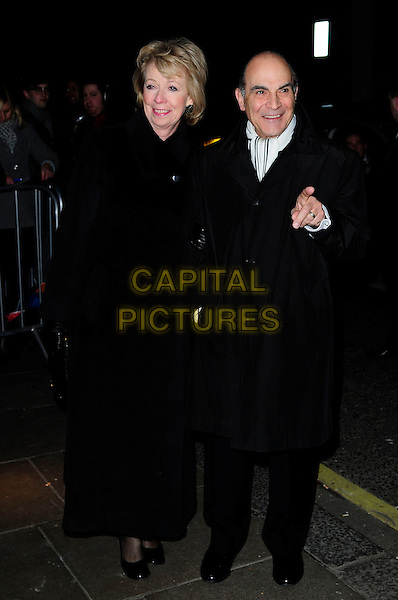 SHEILA FERRIS & DAVID SUCHET .London Evening Standard Theatre Awards, The Savoy, Strand, London.England, UK, November 28th 2010..full length black coat finger hand white scarf married husband wife couple .CAP/CAS.©Bob Cass/Capital Pictures.