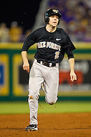 Mark Rhine #2 of the Wake Forest Demon Deacons hustles towards third base against the LSU Tigers at Alex Box Stadium on February 18, 2011 in Baton Rouge, Louisiana.  The Tigers defeated the Demon Deacons 15-4.  Photo by Brian Westerholt / Four Seam Images