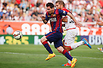 Rayo Vallecano´s Morcillo (R) and Barcelona´s Leo Messi during La Liga match between Rayo Vallecano and Barcelona at Vallecas stadium in Madrid, Spain. October 04, 2014. (ALTERPHOTOS/Victor Blanco)