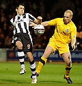 ST MIRREN'S STEVEN THOMPSON AND AYR UNITED'S CHRIS SMITH CHALLENGE FOR THE BALL.