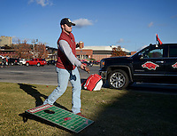 NWA Democrat-Gazette/BEN GOFF @NWABENGOFF<br /> Brennan Dooly of Fort Smith plays cornhole on Saturday Nov. 21, 2015 while tailgating before the Arkansas football game against Mississippi State in Fayetteville.
