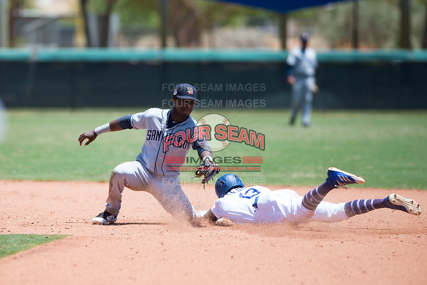 AZL Padres 2 shortstop Jordy Barley (55) applies the tag to Rolando Lebron (13) on a stolen base attempt during an Arizona League game against the AZL Dodgers at Camelback Ranch on July 4, 2018 in Glendale, Arizona. The AZL Dodgers defeated the AZL Padres 2 9-8. (Zachary Lucy/Four Seam Images)