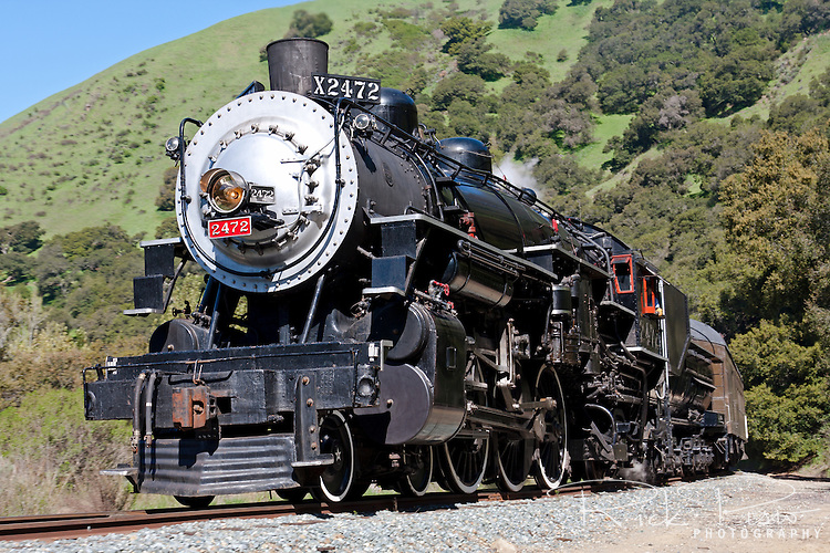 Former Southern Pacific Locomotive 2472 steams through Niles Canyon. Built by the Baldwin Locomotive Works in 1921, and used by the Southern Pacific Railroad until its retirement in 1956, No. 2472 was restored to operation by the Pacific Locomotive Association in 1999. The 150 ton steam locomotive now runs through Niles Canyon as part of the Niles Canyon Railway.