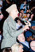 US Navy veteran Tony Woody asks a question about the treatment of veterans to Republican presidential candidate Donald Trump at a rally at Winnacunnet High School in Hampton, New Hampshire. Trump leads Republican polls in New Hampshire and nationally.  Campaign staffers said approximately 2000 people attended the rally. There were 750 seats in the auditorium, 1000 in the overflow area in the cafeteria, and both areas had people standing and sitting in any available space. People stood outside the school to listen to the speeches on loudspeakers, as well.