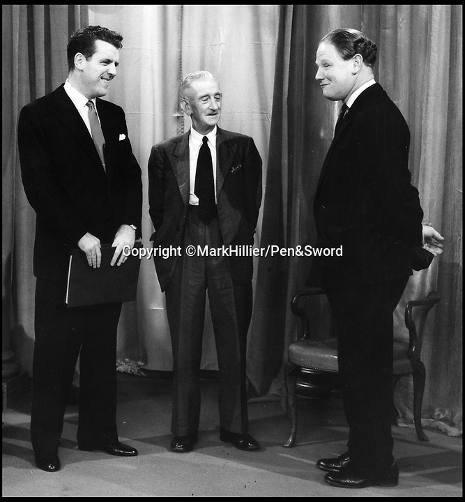 BNPS.co.uk (01202 558833)<br /> Pic: MarkHillier/Pen&Sword/BNPS<br /> <br /> Colin, on the right, pictured with Eamon Andrews (left) and Fred Massey after the filming of This is Your Life on 7 October 1957.<br /> <br /> he remarkable story of a British hero double amputee pilot who took to the skies during the Second World War has come to light.<br /> <br /> Flight Lieutenant Colin Hodgkinson lost his legs in a horror crash in a Tiger Moth in May 1939 but went on to emulate Sir Douglas Bader and fly Spitfires in the Royal Air Force.<br /> <br /> He even endured a spell in the Great Escape prisoner of war camp after being shot down over France in 1943 but rejoined the RAF after being repatriated.<br /> <br /> The pair were the only two British double amputee pilots to fly during the war - yet while Bader, rightly, is a household name, Flt Lt Hodgkinson's exploits have been largely forgotten.<br /> <br /> This has prompted historian Mark Hillier to publish Flt Lt Hodgkinson's autobiography 60 years after it was penned which he hopes will shine some limelight on a 'special' man whose courage he says was every bit as great as Baders'.<br /> <br /> Best Foot Forward, by Colin Hodgkinson, is published by Pen & Sword.