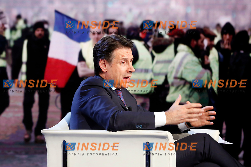Giuseppe Conte and on the video French yellow jackets protesting<br /> Rome January 8th 2019. The Italian Prime Minister appears as a guest on the tv show Porta a Porta<br /> Foto Samantha Zucchi Insidefoto