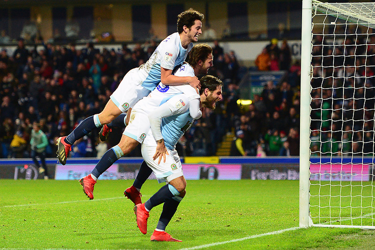 Blackburn Rovers' Bradley Dack celebrates scoring his side's second goal with his team-mates Danny Graham and Lewis Travis (L)<br /> <br /> Photographer Richard Martin-Roberts/CameraSport<br /> <br /> The EFL Sky Bet Championship - Blackburn Rovers v West Bromwich Albion - Tuesday 1st January 2019 - Ewood Park - Blackburn<br /> <br /> World Copyright © 2019 CameraSport. All rights reserved. 43 Linden Ave. Countesthorpe. Leicester. England. LE8 5PG - Tel: +44 (0) 116 277 4147 - admin@camerasport.com - www.camerasport.com
