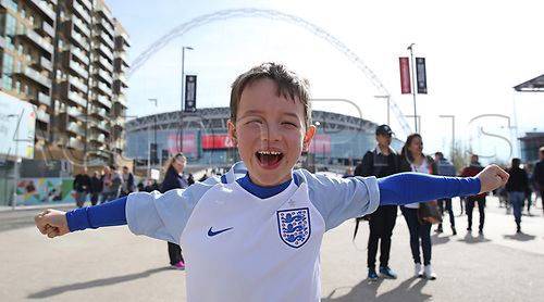 March 26th 2017, Wembley Stadium, London, England; World Cup 2018 Qualification football, England versus Lithuania; Young England fan posing with a big form glove outside Wembley Stadium