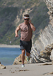 AbilityFilms@yahoo.com.805-427-3519.www.AbilityFilms.com.....4-11-09.Exclusive .Matthew McConaughey running jogging & playing fetch on the beach with his dog in Malibu ca