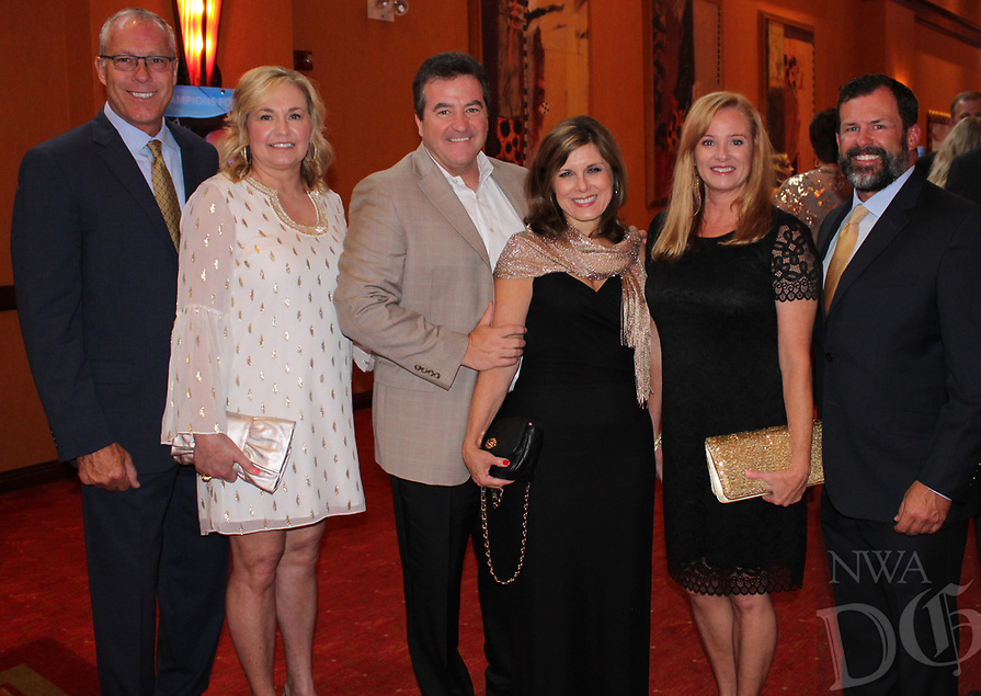 NWA Democrat-Gazette/CARIN SCHOPPMEYER Mike and Jill Sewell (from left), Tony and Cheri Murphy and Melane and Kyden Reeh attend the Color of Hope Gala. Mike, Tony and Kyden are chairmen of the accompanying Will Golf 4 Kids tournament fundraiser.