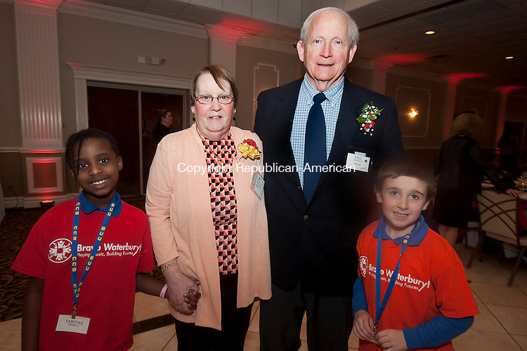 WATERBURY,  CT,  CT-032415JS10- Children's Community School students Tabitha Richaards, 8, left, and Anthony Zabilski, 8, right, with award recipients Eileen and Paul McDonald, at the Children's Community School's annual awards dinner held at La Bella Vista at the Pontelandolfo Club in Waterbury. The McDonald's received the Business Partner Award on behalf of the Quassapaug Outing Club. <br /> Jim Shannon Republican-American