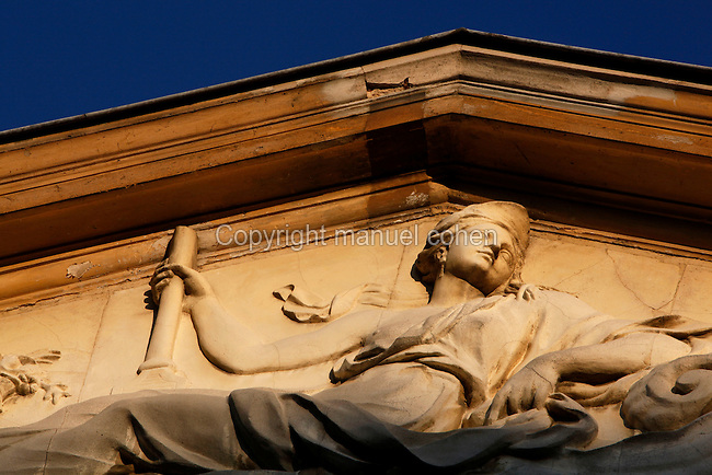 Detail of the pediment of the Hotel de Magny (formerly Pavillon Cuvier) which houses the Cabinet d'Histoire (History office), was built between 1696 and 1700 by Pierre Bullet and is located in the Jardin des Plantes, Paris, 5th arrondissement, France. Founded in 1626 by Guy de La Brosse, Louis XIII's physician, the Jardin des Plantes, originally known as the Jardin du Roi, opened to the public in 1640. It became the Museum National d'Histoire Naturelle in 1793 during the French Revolution. Picture by Manuel Cohen
