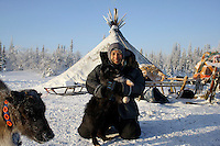 Photographer Justin Jin, with a Samoyed Husky, in front a choom (tent) in Naryan-Mar in Arctic Russia. /Felix Features
