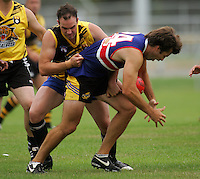 Tiger's Darren West tackles Conrad Smith during the Preseason Cross-code Rugby Union v Australian Rules friendly between the Hurricanes and Wellington Tigers at  Elsdon Park, Porirua, New Zealand on Tuesday, 15 January 2008. Photo: Dave Lintott / lintottphoto.co.nz