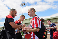 Lincoln City's Nathan Arnold signs an autograph for a fan before the game<br /> <br /> Photographer Chris Vaughan/CameraSport<br /> <br /> The EFL Sky Bet League Two - Lincoln City v Morecambe - Saturday August 12th 2017 - Sincil Bank - Lincoln<br /> <br /> World Copyright &copy; 2017 CameraSport. All rights reserved. 43 Linden Ave. Countesthorpe. Leicester. England. LE8 5PG - Tel: +44 (0) 116 277 4147 - admin@camerasport.com - www.camerasport.com