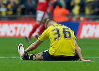 Jordan Evans of Oxford United looks dejected after loosing the Johnstone's Paint Trophy Final match between Oxford United and Barnsley at Wembley Stadium, London, England on 3 April 2016. Photo by Alan  Stanford / PRiME Media Images.