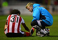 Lincoln City's Lee Angol receives treatment for an injury from Lincoln City's head of sports science and medicine Mike Hine<br /> <br /> Photographer Chris Vaughan/CameraSport<br /> <br /> Vanarama National League - Lincoln City v Chester - Tuesday 11th April 2017 - Sincil Bank - Lincoln<br /> <br /> World Copyright &copy; 2017 CameraSport. All rights reserved. 43 Linden Ave. Countesthorpe. Leicester. England. LE8 5PG - Tel: +44 (0) 116 277 4147 - admin@camerasport.com - www.camerasport.com