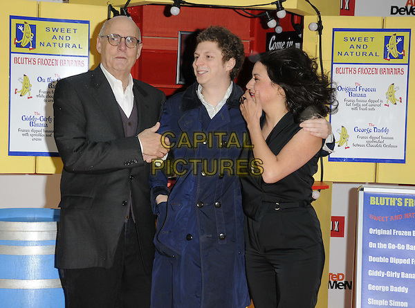 """Jeffrey Tambor, Michael Cera & Alia Shawkat.attended the """"Arrested Development, Season 4"""" UK TV premiere, Vue West End cinema, Leicester Square, London, England, UK, .9th May 2013..half length blue navy trench coat mac .CAP/CAN.©Can Nguyen/Capital Pictures."""