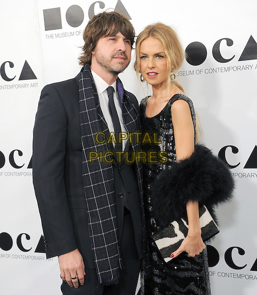 "Rodger Berman & Rachel Zoe.at The 2011 MOCA Gala ""An Artist's Life Manifesto"" With Artistic Direction From Marina Abramovic held at MOCA Grand Avenue in Los Angeles, California, USA, .November 13th 2011..half length  sleeveless checked scarf married husband wife  couple  black fur fluffy black wrap shawl long maxi sequined sequin .CAP/RKE/DVS.©DVS/RockinExposures/Capital Pictures."