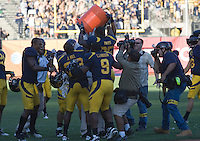 September 17, 2011:  California Football players dump jug full of water on Jeff Tedford's 75th win after beating Presbyterian at AT&T Park, San Francisco, Ca   California defeated Presbyterian 63-12