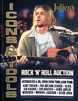 BNPS.co.uk (01202 558833)<br /> Pic: Julien's/BNPS<br /> <br /> The £600,000 items are being sold in Julien's prestigious 'Rock'n'Roll' auction later this month.<br /> <br /> This unwashed old cardy might smell like teen spirit...but its expected to sell for a whopping £200,000 at auction later this month.<br /> <br /> It's the cardigan Kurt Cobain wore during the lconic MTV Unplugged performance by Nirvana in November 1993.<br /> <br /> Also being sold is the custom made left handed Fender Mustang electric guitar Cobain took it on tour with him in 1993 and '94.<br /> <br /> Amazingly the £400,000 guitar was gifted to a fan who wrote to Courtney Love after the Nirvana frontman's tragic suicide in 1994.<br /> <br /> The two items are being auctioned off to mark the 25th anniversary of the rock star's untimely death.