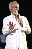 """20 March 2020 - Kenny Rogers, whose legendary music career spanned nearly six decades, has died at the age of 81. Rogers was inducted to the Country Music Hall of Fame in 2013."""" He had 24 No. 1 hits and through his career more than 50 million albums sold in the US alone. He was a six-time Country Music Awards winner and three-time Grammy Award winner. Some of his hits included """"Lady,"""" """"Lucille,"""" """"We've Got Tonight,"""" """"Islands In The Stream,"""" and """"Through the Years."""" His 1978 song """"The Gambler"""" inspired multiple TV movies, with Rogers as the main character. File Photo: June 20, 2009 - Mableton, GA - Kenny Rogers performed at the Mablehouse Amphitheater. Photo Credit: Dan Harr/AdMedia"""
