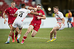 Dan Norton (left) and Ruaridh McConnochie (right) of England try to stop Isaac Kaay of Canada, who runs with the ball during the match Canada vs England, Day 2 of the HSBC Singapore Rugby Sevens as part of the World Rugby HSBC World Rugby Sevens Series 2016-17 at the National Stadium on 16 April 2017 in Singapore. Photo by Victor Fraile / Power Sport Images