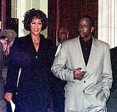 Whitney Houston and her husband, Bobby Brown arrive at a Capitol Hill Press confrence in Washington, D.C. on October 1, 1997.  Ms. Houston announced an HBO special to be aired Sunday, October 5, 1997, live from DAR Constitution Hall in Washington to benefit the Children's Defense Fund..Credit: Ron Sachs / CNP