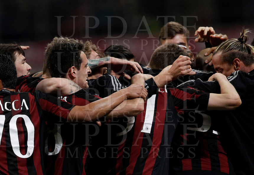 Calcio, Serie A: Milan vs Juventus. Milano, stadio San Siro, 9 aprile 2016. <br /> AC Milan's Alex is hidden by teammates' hugs after scoring during the Italian Serie A football match between AC Milan and Juventus at Milan's San Siro stadium, 9 April 2016.<br /> UPDATE IMAGES PRESS/Isabella Bonotto