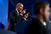 US President Barack Obama (L) delivers remarks on immigration reform, behind a US Secret Service agent (R), at the Congressional Hispanic Caucus Institute's 37th Annual Awards Gala, in Washington DC, USA, 02 October 2014.<br /> Credit: Michael Reynolds / Pool via CNP