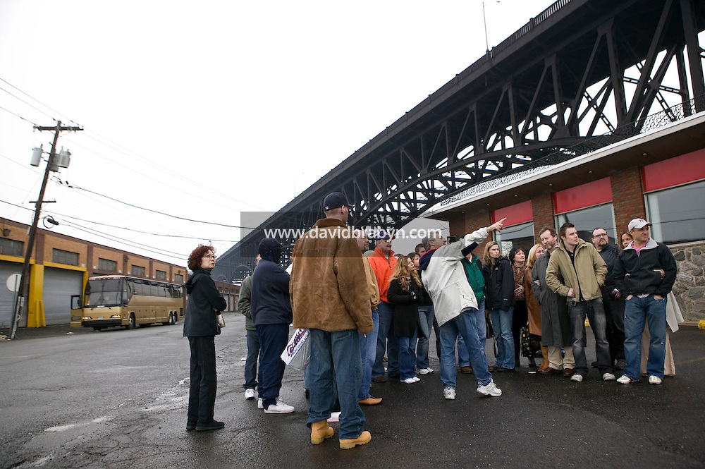 12 March 2006 - South Kearny, NJ - Participants in a tour of locations featured in the hit television mob show The Sopranos listens to the tour guide Marc Baron (pointing) in South Kearny, USA, near the Pulaski Skyway, 12 March 2006.