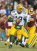 Green Bay Packers quarterback Aaron Rodgers (12) looks for a receiver in second quarter action against the Washington Redskins in an NFC Wild Card game at FedEx Field in Landover, Maryland on Sunday, January 10, 2016.  The Packers won the game 35 - 18.<br /> Credit: Ron Sachs / CNP